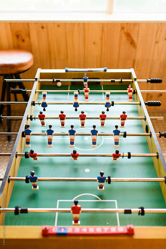 Soccer table game by Lawren Lu for Stocksy United