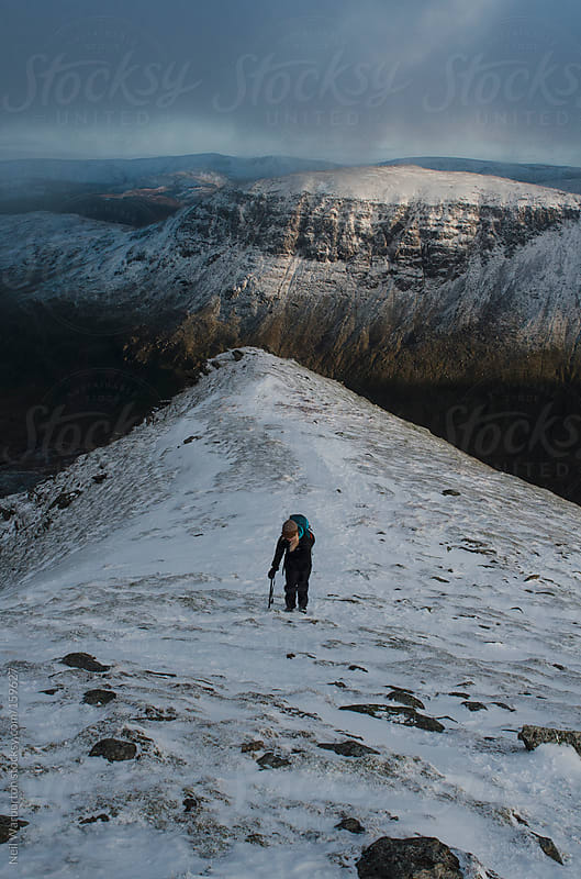 Female Mountaineer on a Ridge by Neil Warburton for Stocksy United