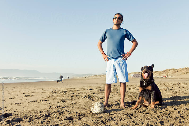 Latino-American Man and his Pet Dog by Joselito Briones for Stocksy United