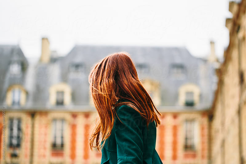 Woman with long red hair, from behind by michela ravasio for Stocksy United