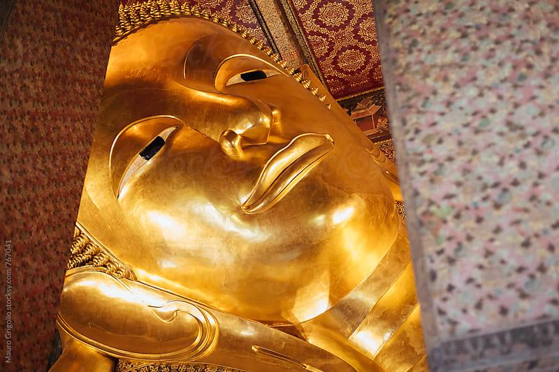 Reclining Buddha inside a temple in Bangkok by Mauro Grigollo for Stocksy United