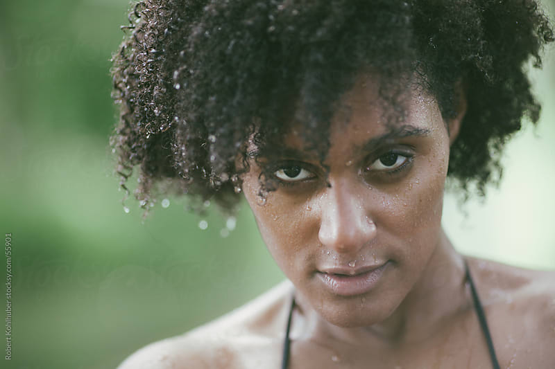 Black woman with wet hair by Robert Kohlhuber for Stocksy United