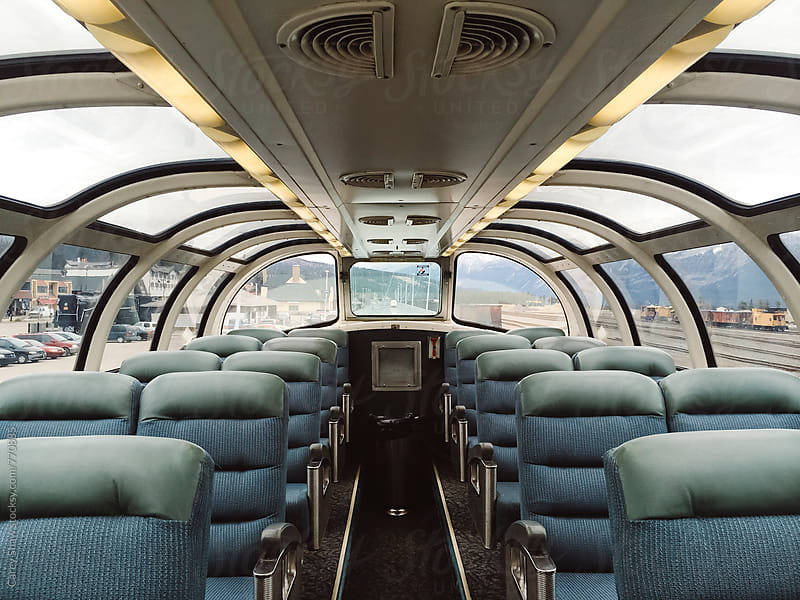 Sky dome and seats on travelling train by Carey Shaw for Stocksy United