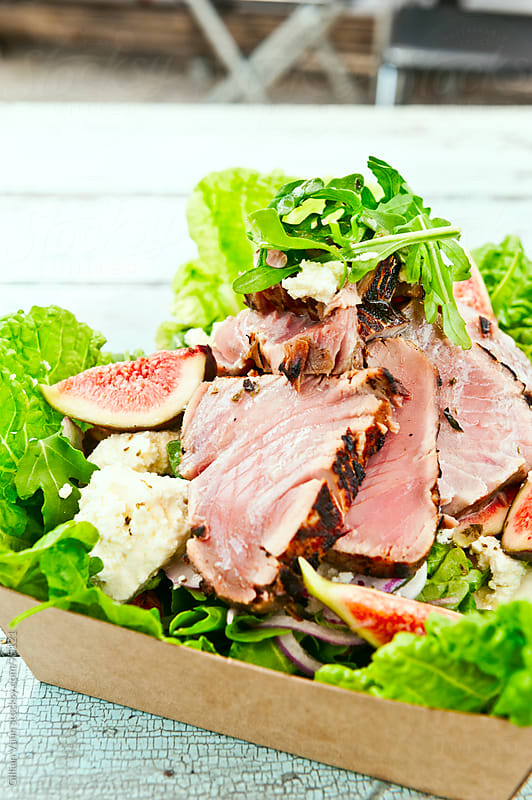 tuna salad with fresh fig by Gillian Vann for Stocksy United