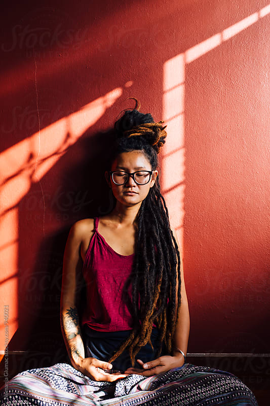 Thai Woman With Dreadlocks Meditating by Nemanja Glumac for Stocksy United