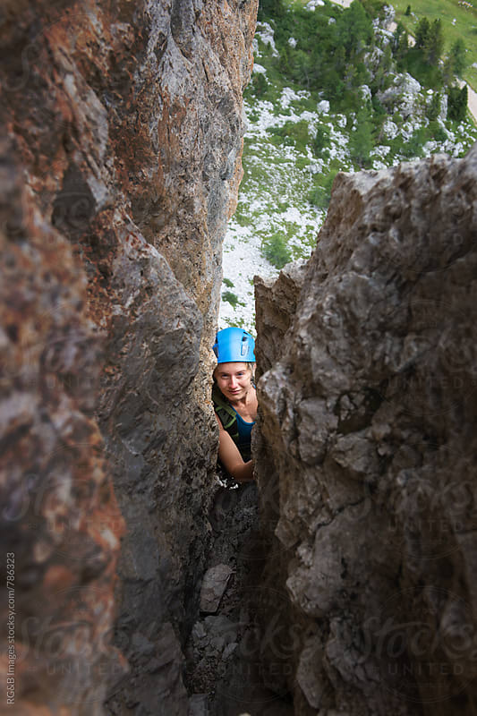 Female alpinist rock climbing outdoor by RG&B Images for Stocksy United