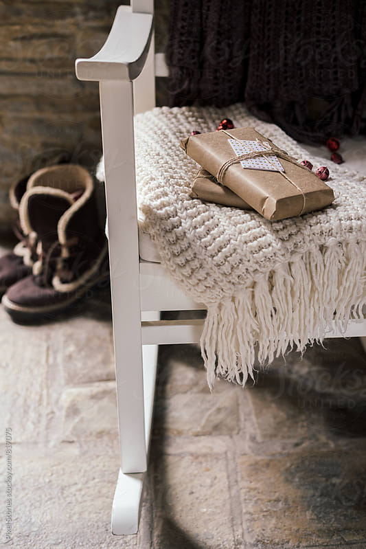 Comfy rocking chair with presents by Pixel Stories for Stocksy United