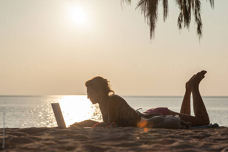 Woman Using Laptop at the Beach by Mosuno for Stocksy United