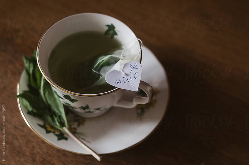 A cup of mint tea. by Helen Rushbrook for Stocksy United