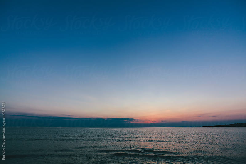 Sunset over the sea by Borislav Zhuykov for Stocksy United