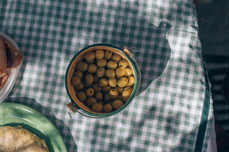 Olives on the table by Lydia Cazorla for Stocksy United