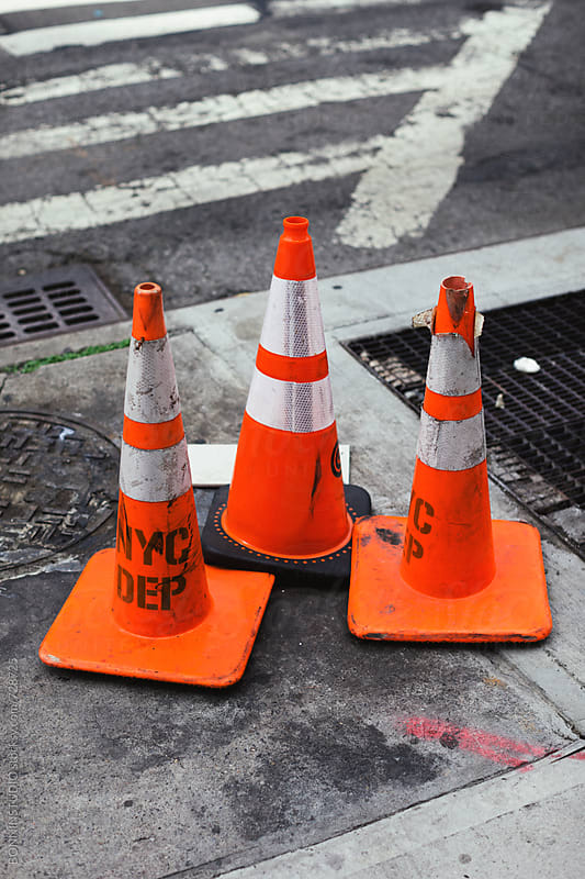 Three cones on the street. by BONNINSTUDIO for Stocksy United