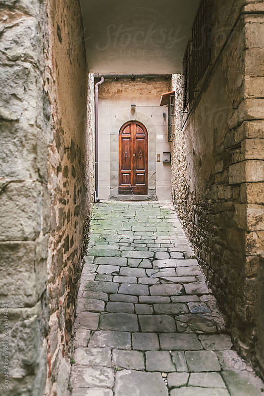 Small Passage to a Wooden Door in the Old Town by Giorgio Magini for Stocksy United