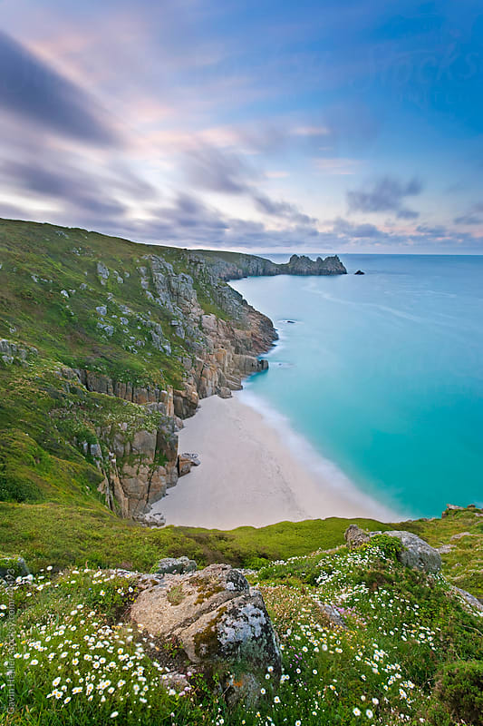 Pednvounder Beach and Logan Rock from Treen Cliff, Porthcurno, Cornwall, England, United Kingdom, Europe by Gavin Hellier for Stocksy United