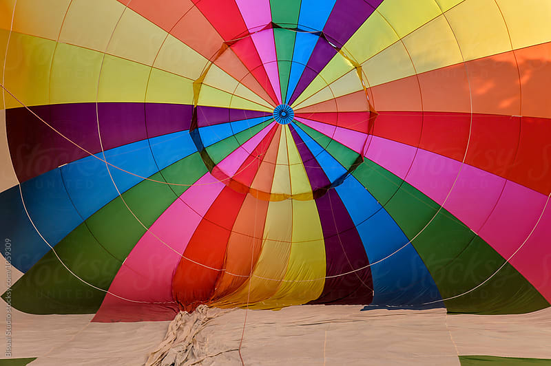 Blowing up hot air balloons by Bisual Studio for Stocksy United