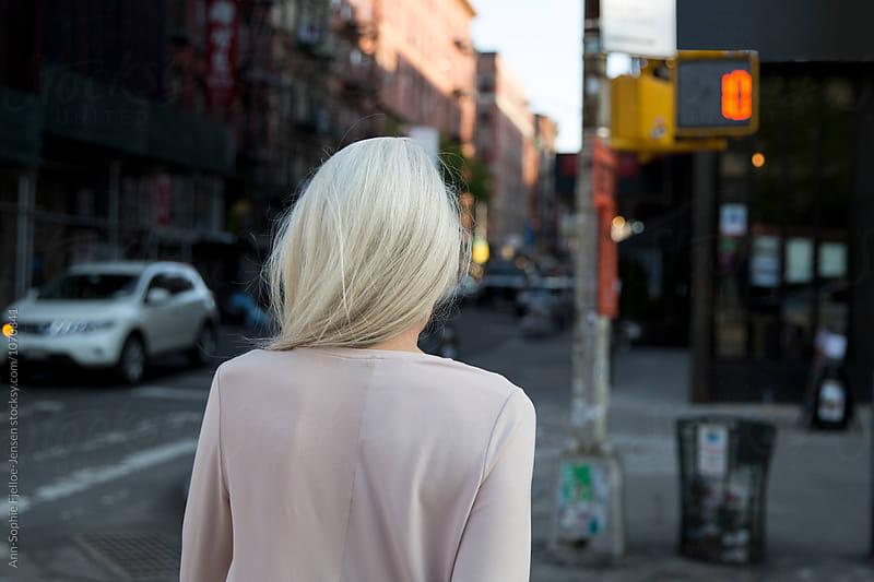 Lady crossing a street by Ann-Sophie Fjelloe-Jensen for Stocksy United