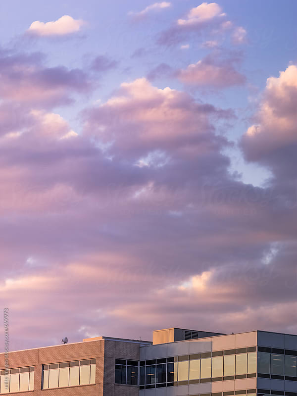 building roof against cloudy sky by unite images for Stocksy United