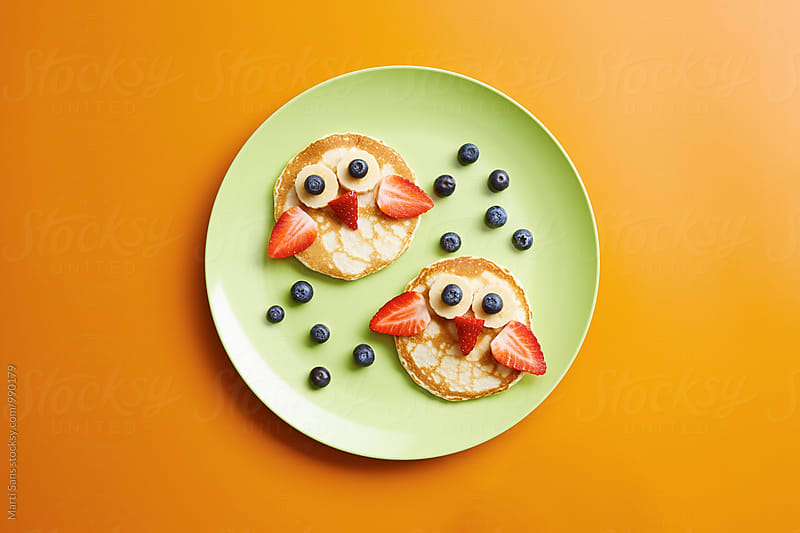Funny pancake owls on green plate by Martí Sans for Stocksy United