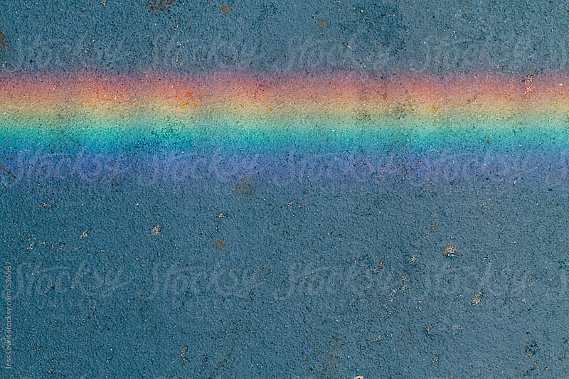 rainbow of light on concrete background by Jess Lewis for Stocksy United