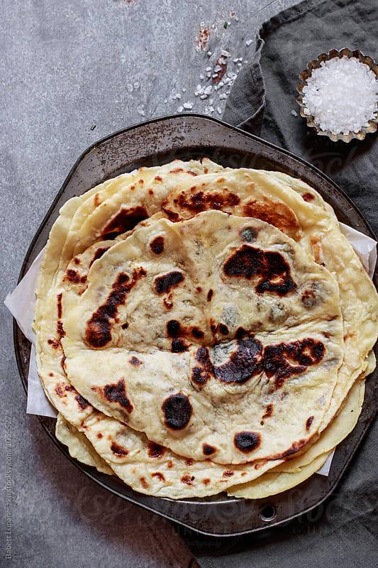 Homemade flat bread by Babett Lupaneszku for Stocksy United