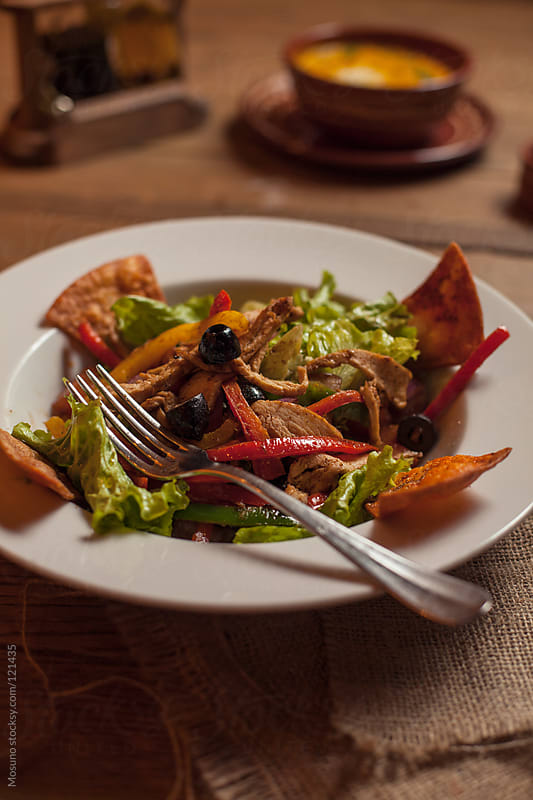 Mexican Salad With Nachos, Olives and Vegetables by Mosuno for Stocksy United