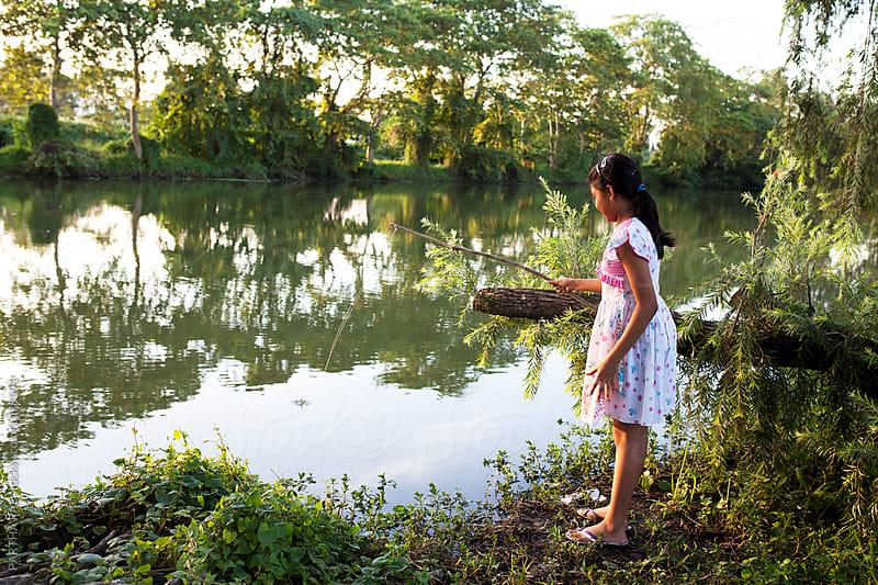 A teenage girl enjoying fishing activity by PARTHA PAL for Stocksy United