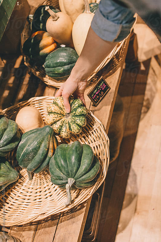 Selecting Groceries  by Gabrielle Lutze for Stocksy United