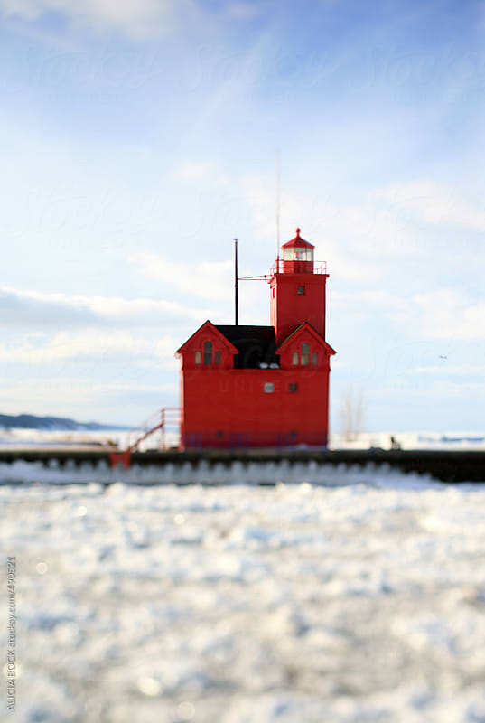 Big Red Lighthouse In Holland Michigan In Winter by ALICIA BOCK for Stocksy United