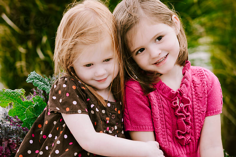Little Girl Sisters Outside by Jani Bryson for Stocksy United