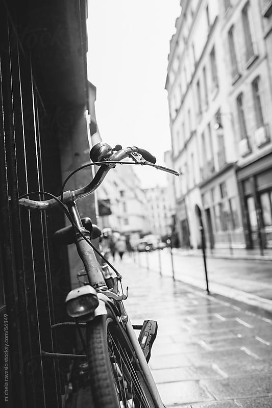 Bicycle on a street in Paris by michela ravasio for Stocksy United