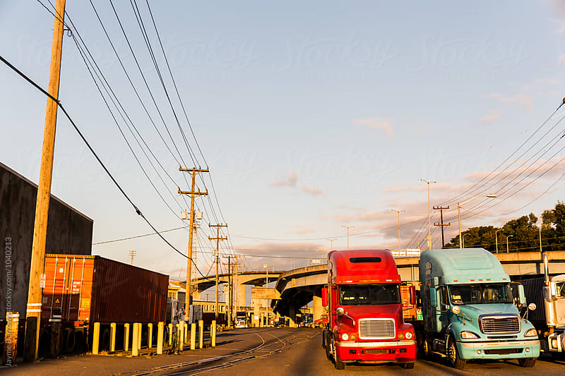 Trucks Ready at a Port by Jayme Burrows for Stocksy United