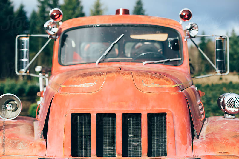 Windshield, Hood, And Grill Of Old Rusty Red Fire Truck by Luke Mattson for Stocksy United