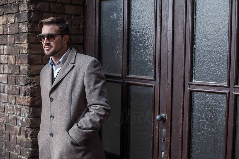 Handsome Man in a Coat Standing Outside by Mosuno for Stocksy United