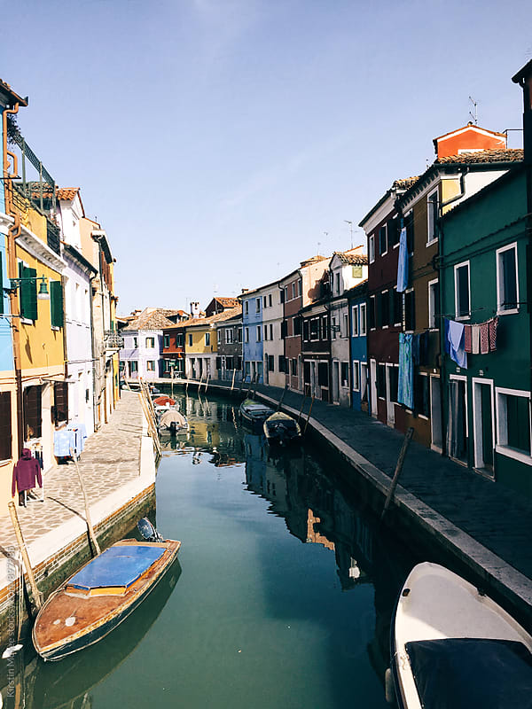 Boats in canal in Burano by Kirstin Mckee for Stocksy United