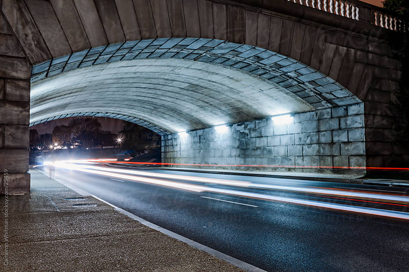 Car Speeding Under The Arlington Memorial Bridge by Cameron Whitman for Stocksy United