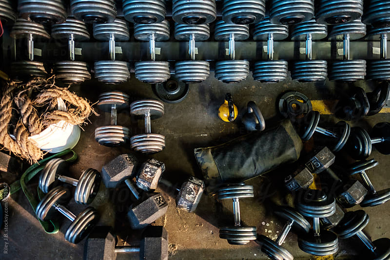 Dumbbells, kettlebells and a sandbag from above by Riley J.B. for Stocksy United