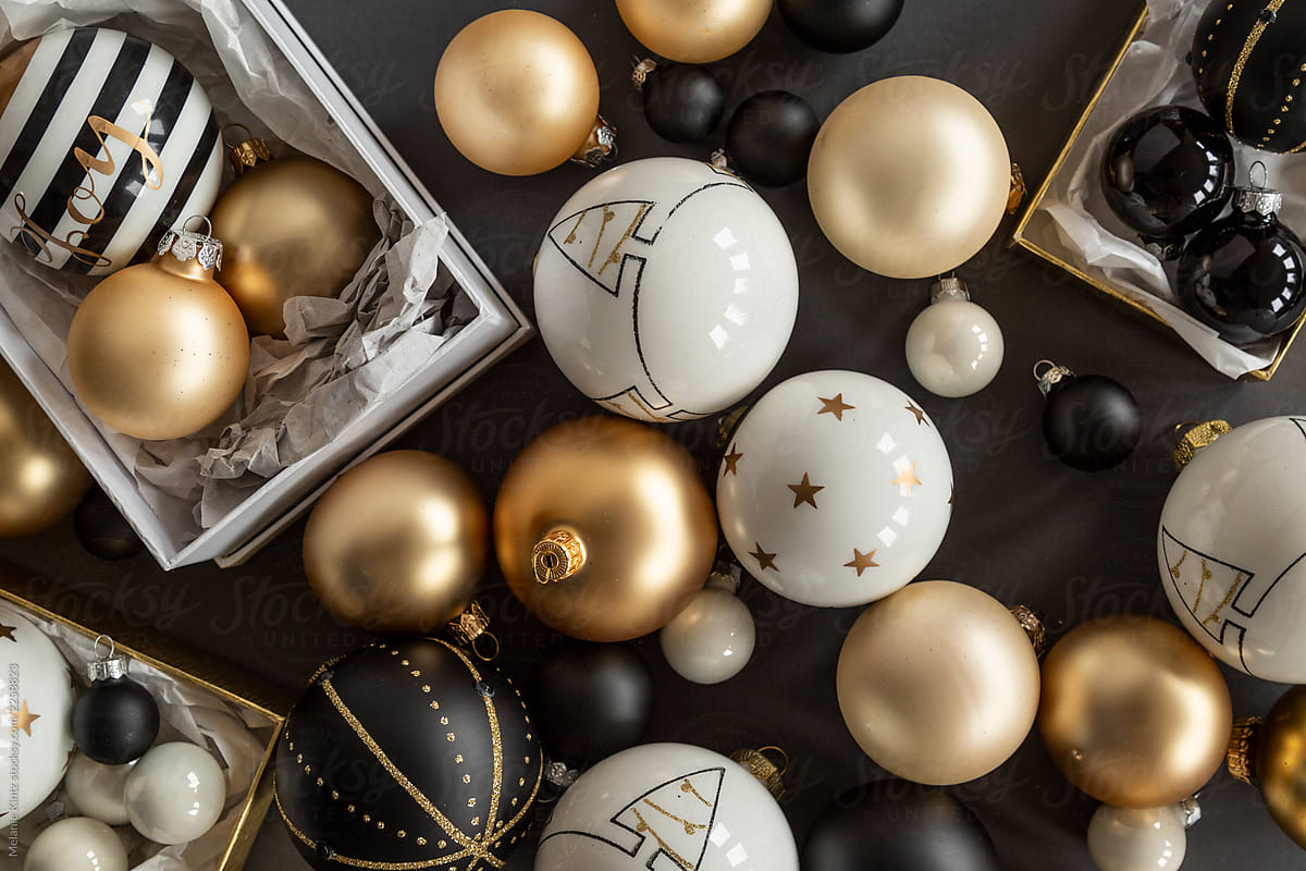 Black White And Gold Christmas Ornaments On Grey Background By