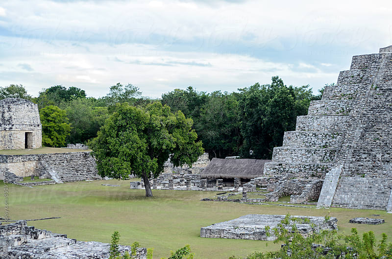 Ruins of Mayan pyramids surrounded by jungle by Alice Nerr for Stocksy United