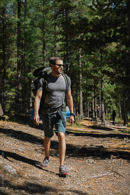 Man hiking at forest by Milles Studio for Stocksy United