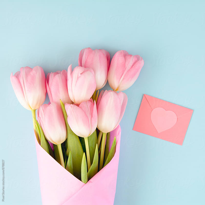 Pastel pink Valentine's Day card and tulips by Pixel Stories for Stocksy United