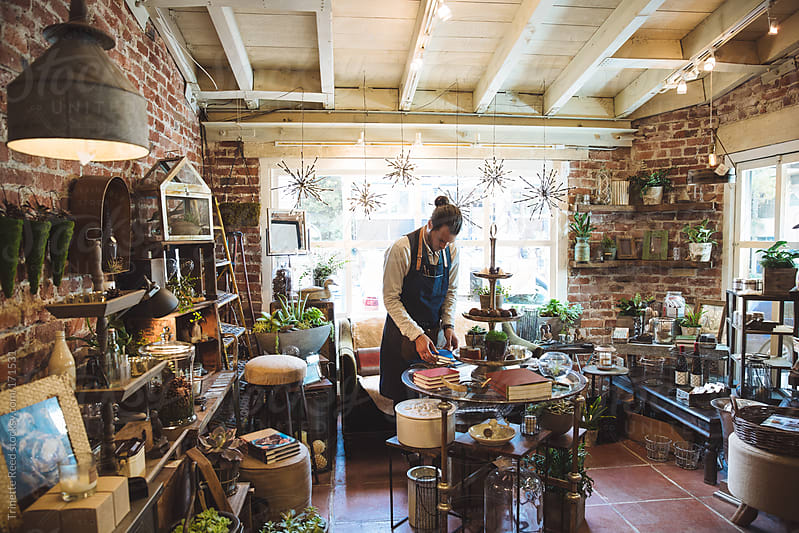 Small artisan business owner in shop by Trinette Reed for Stocksy United