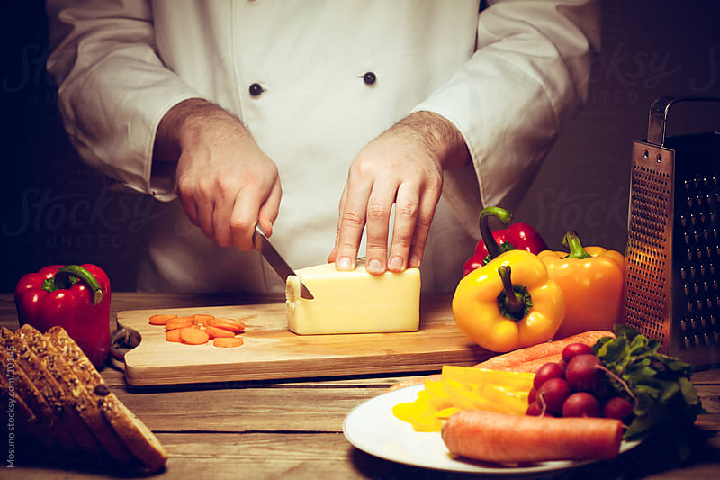 Chef Cutting Cheese by Mosuno for Stocksy United