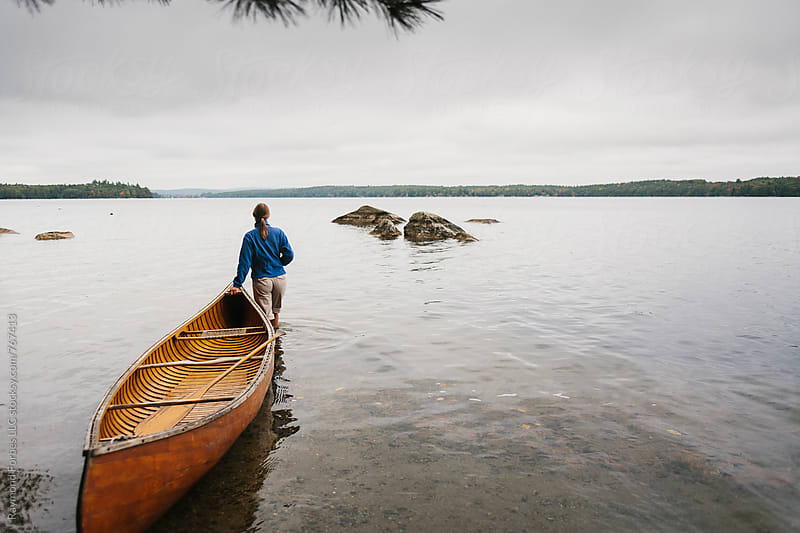 Landscape with Canoe in Maine by Raymond Forbes LLC for Stocksy United