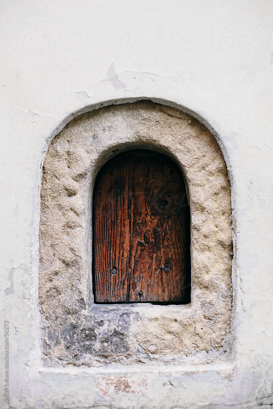 Small renaissance stone window in a Florentine store-front. by Sarah Lalone for Stocksy United