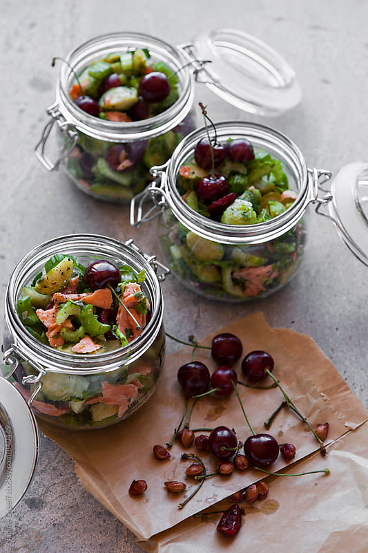 Brussel sprout, cherry and smoked salmon salad by Nadine Greeff for Stocksy United