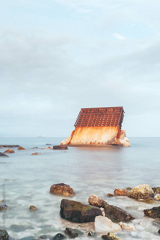 Abandoned concrete slab on the beach by ACALU Studio for Stocksy United