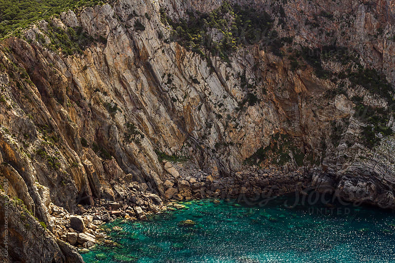 Aerial view of blue sea from a cliff, Sardinia by Luca Pierro for Stocksy United