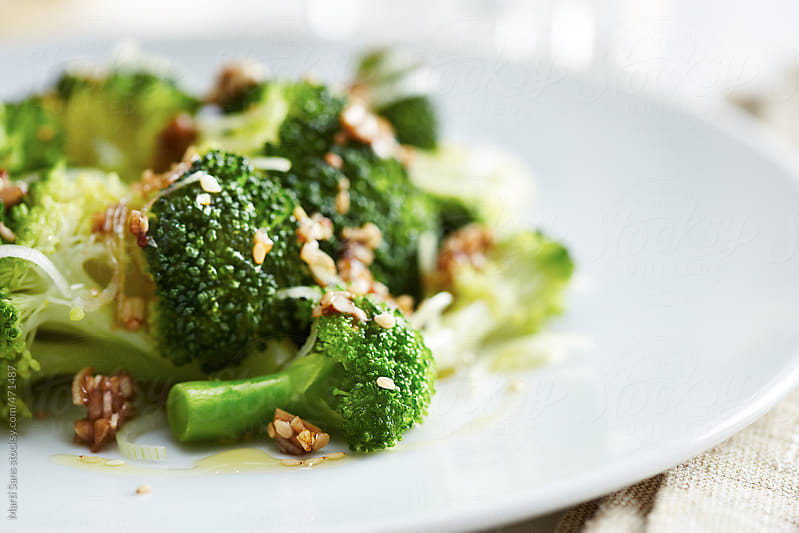 Steamed broccoli dish by Martí Sans for Stocksy United