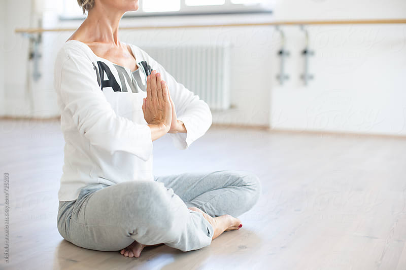 Woman doing the lotus posture by michela ravasio for Stocksy United