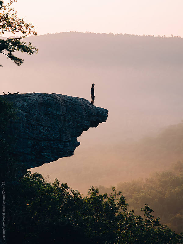Man on cliff. Hawksbill Crag, Arkansas. by Jeremy Pawlowski for Stocksy United